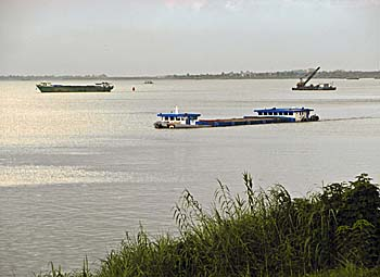 Freighters on the Mekong River at Phnom Penh by Asienreisender