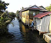 Water Channel and Malay Houses in Kampot by Asienreisender