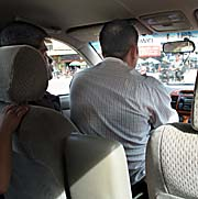 'Cambodian Driver with a Passenger on his Seat' by Asienreisender