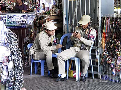 'Armed Security Staff at Phsar Thmei, Phnom Penh' by Asienreisender