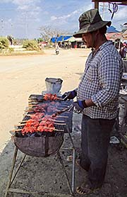 'A Khmer, Grilling Chicken at the Roadside' by Asienreisender