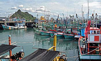 'Fisherboats at the Pier of Prachuap Khiri Khan' by Asienreisender