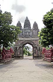 'Angkor Thom Gate in Front of a Temple in Battambang' by Asienreisender