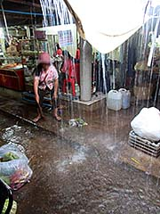 'Heavy Rain is Flooding Kampot Fresh Market' by Asienreisender