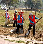 'Cleaning Staff at Work in Ayutthaya Historical Park' by Asienreisender