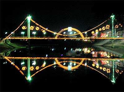 'An Illuminated Bridge over the Wang River in Lampang' by Asienreisender