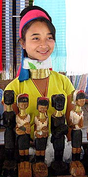 'A Kayan Girls with Brass Bracelet in a Souvenir Shop in Ban Nai Soi' by Asienreisender