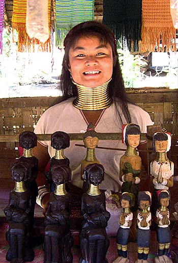 'Young Kayan Woman in a Souvenir Shop in Nai Soi' by Asienreisender