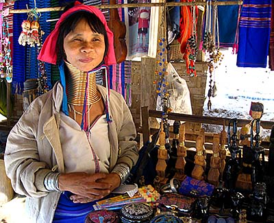 'A Kayan Woman with a Brass Coil in a Shop in Nai Soi Village' by Asienreisender