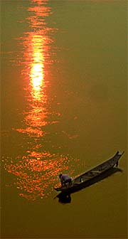 'A Simple Fishing Boat on the Mekong River' by Asienreisender