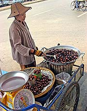 'A Chestnut Saleswoman at the Main Road in Mae Sai' by Asienreisender
