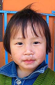 'A Tribal Child in a Kindergarden in Chiang Saen District' by Asienreisender