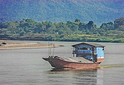 'A Wooden Laotian Transport Ship on the Mekong River at Chiang Khong' by Asienreisender