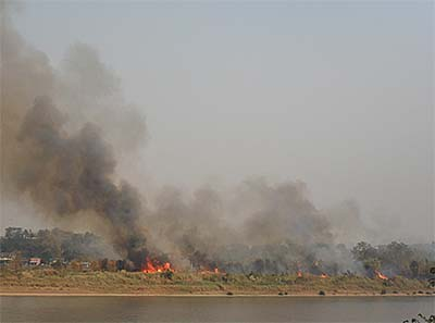 'A Large Bush Fire in a Mekong River Island between Chiang Khong and Houayxay' by Asienreisender